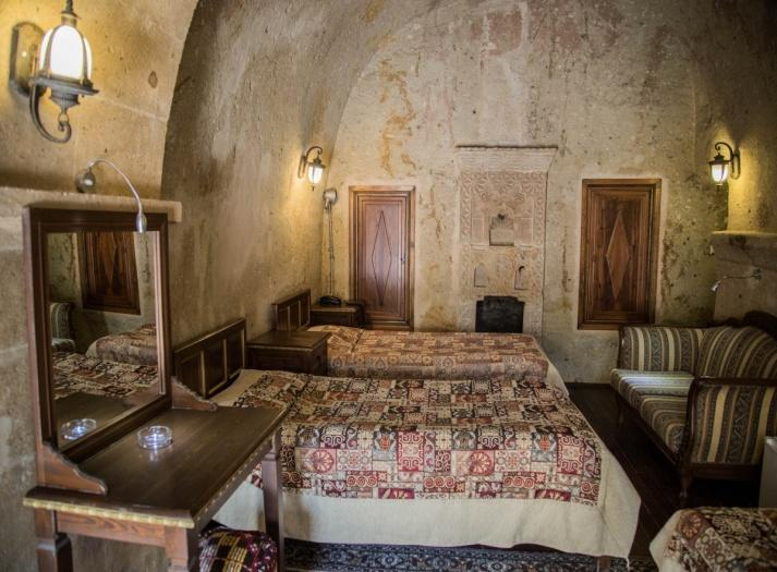 cheap hotels in Cappadocia Turkey - Cappadocia Palace Hotel The decor of the hotel is elegant and personalized with beautiful hand-crafted furnishings and antiques.